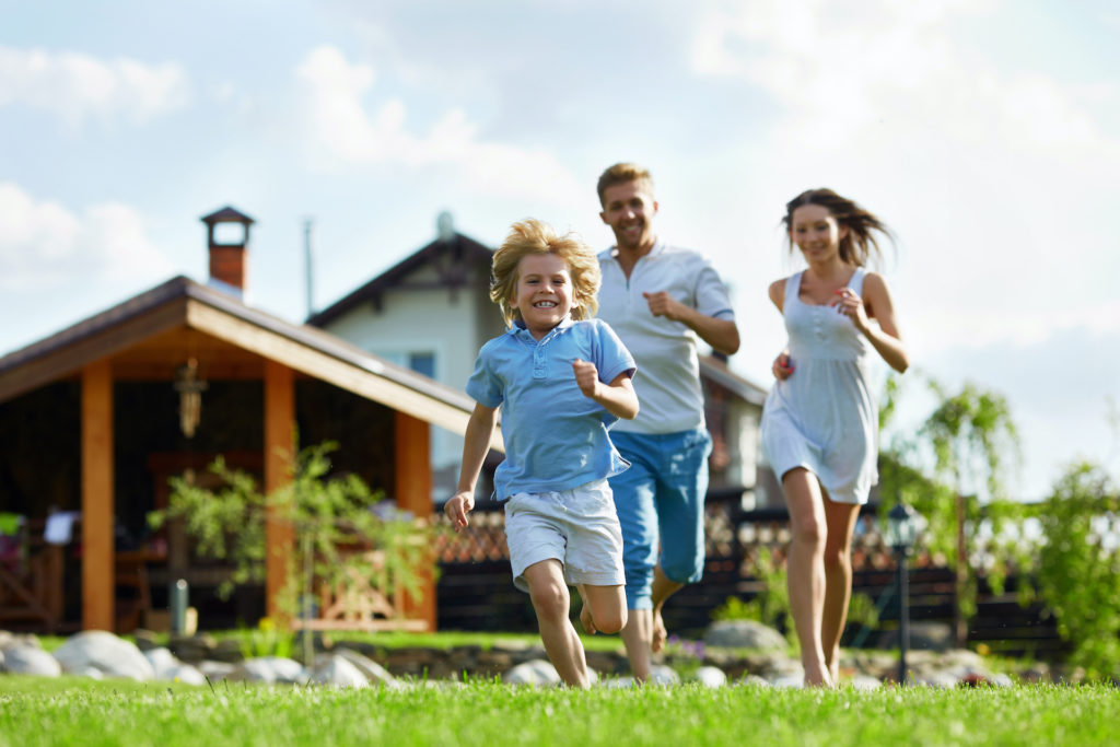 Running,People,On,A,Lawn,At,The,House